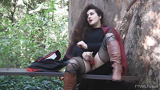 Outdoor solo clothed masturbation set-to with curly haired Lili