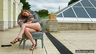 Tattooed Euro beauty flashes her shaved pussy outdoors