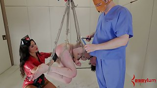Horny mistress wearing strapon fucks tied almost and suspended porn model