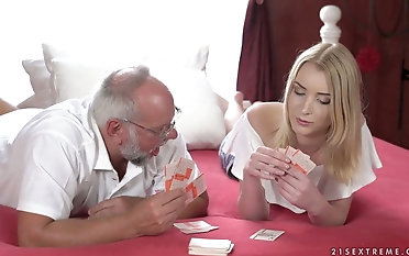 Beautiful young blonde Amaris is carrying-on strip poker with one old fart
