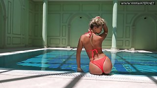 Attractive auburn hottie Mary Kalisy boasts of their way nice rounded ass in the pool