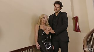 Fake tittied flaxen-haired in black latex dress Christie Stevens is fucked on the stairs