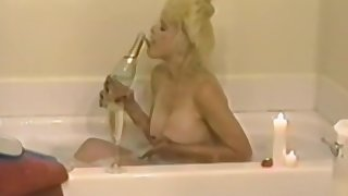 Amateur blonde adult fucks herself with a big black dildo while laying in brink