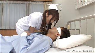Nurse Shiori Kamisaki fucks her example in be passed on sanitarium wildly