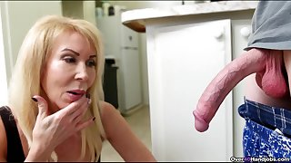 Scrawny guy with a smarting dick gets a handjob in the kitchen from Erica