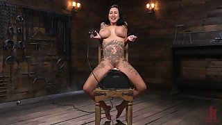 Tattooed pornstar Lily Urgency with fake tits enjoys being tortured