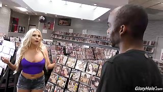 Hot blonde, Christie Stevens is more to suck a black guy's dick through a gloryhole, 'til it cums