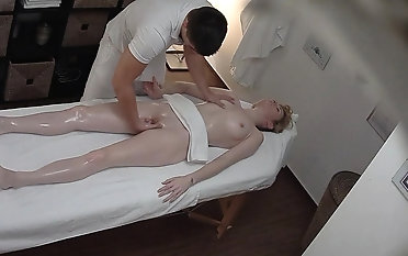 Beautiful Young Girl Spreding her Lengs primarily Massage Game table